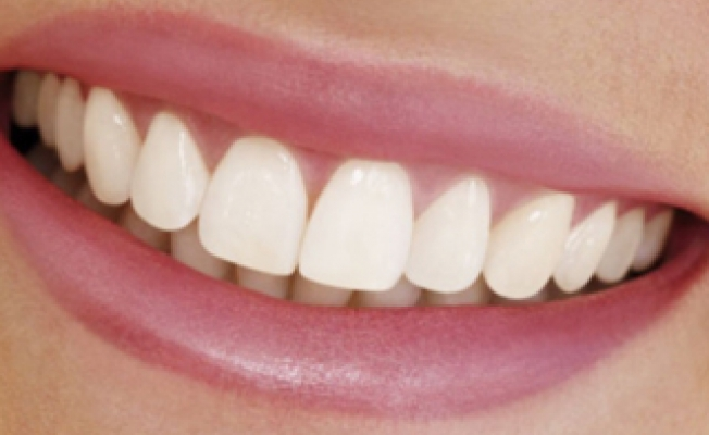 Наращивание зуба: за и против